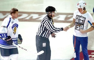 The beautiful referee gave me the puck to drop.